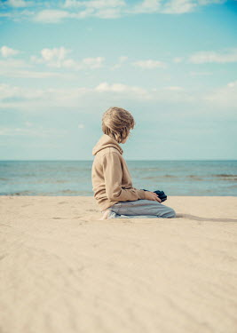Katya Evdokimova Boy sitting on beach