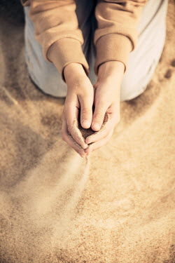 Katya Evdokimova Hands of boy playing with sand on beach