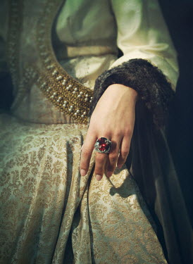 Mark Owen Hand of woman in medieval gown with ruby ring
