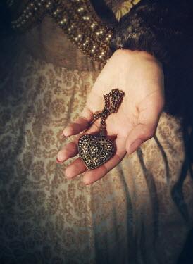 Mark Owen Hand of medieval woman holding heart locket