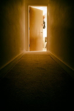 Tim Robinson Corridor in shadow and man peering from behind bedroom door