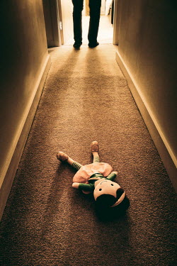 Tim Robinson Doll on floor of shadowy corridor and legs of man walking to bedroom