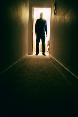 Tim Robinson Man in shadow standing in bedroom doorway