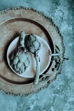 Magdalena Wasiczek artichokes in a ceramic bowl and decorative copper tray