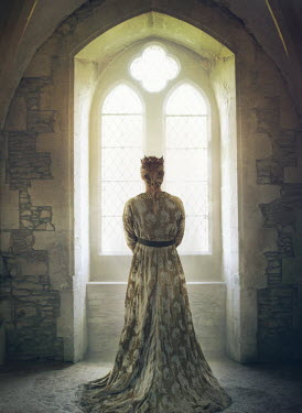 Mark Owen Young woman in medieval gown by window