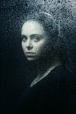 Magdalena Russocka woman behing wet glass