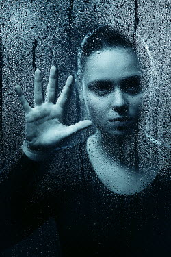 Magdalena Russocka silhouette of woman behind wet glass
