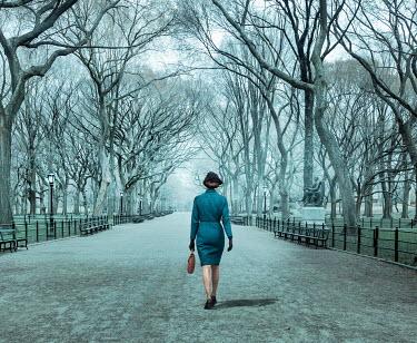 Stephen Mulcahey A woman walking through a park