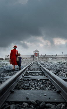 Stephen Mulcahey A woman and boy walking along train tracks