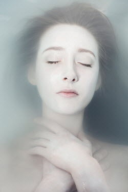 Eva Van Oosten CLOSE UP OF DEAD WOMAN IN WATER FROM ABOVE Women