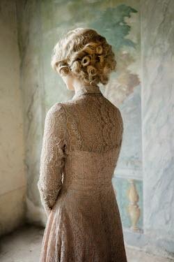 Nikaa BLONDE 1930S WOMAN BY MURAL IN HOUSE Women
