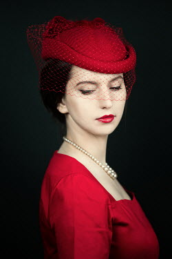 Magdalena Russocka retro woman in red dress and hat