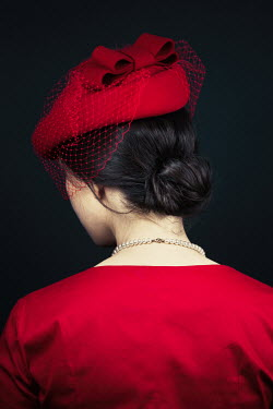 Magdalena Russocka retro woman in red dress and hat from behind