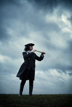 Magdalena Russocka historical man in tricorn hat and long jacket with telescope standing on hill