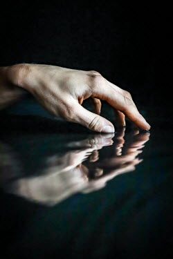 Stephen Carroll REFLECTION OF FEMALE HAND IN WATER Women