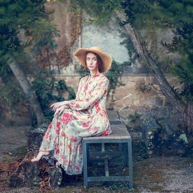 Anna Volynskaia BAREFOOT WOMAN IN FLORAL DRESS SITTING IN GARDEN Women