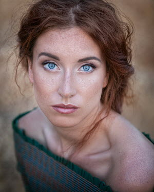 Anna Volynskaia CLOSE UP OF SERIOUS BRUNETTE WOMAN WITH BLUE EYES Women