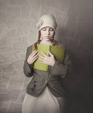 Anna Buczek GIRL IN HAT HOLDING BOOK WITH BACKGROUND OF PAGES Women