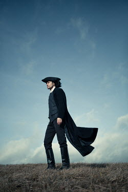 Magdalena Russocka historical man in tricorn hat and long coat standing on hill