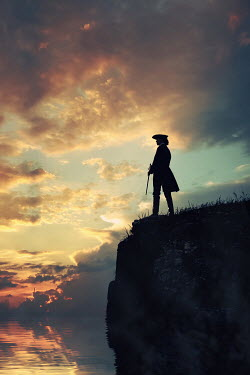 Magdalena Russocka historical man in tricorn hat and long jacket with cane standing on cliff at sunset