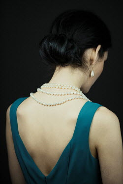Magdalena Russocka elegant woman with pearl necklace from behind