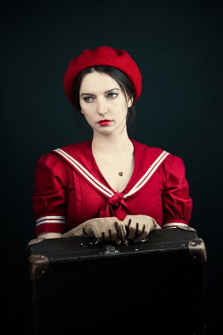 Magdalena Russocka retro woman with suitcase waiting