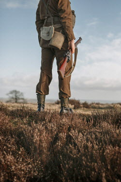 Shelley Richmond SOLDIER CARRYING RIFLE IN COUNTRYSIDE Men