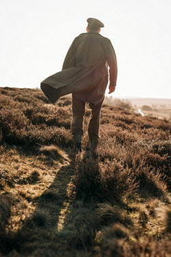 Shelley Richmond SOLDIER IN KHAKI WALKING IN SUNLIT COUNTRYSIDE Men