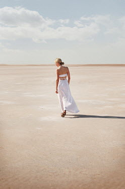 Buffy Cooper WOMAN IN WHITE DRESS WALKING ON SAND Women