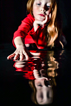 Stephen Carroll LITTLE GIRL IN RED TOUCHING WATER Children