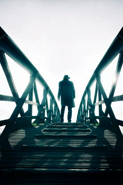 Tim Robinson SILHOUETTED MAN STANDING ON FOOTBRIDGE Men