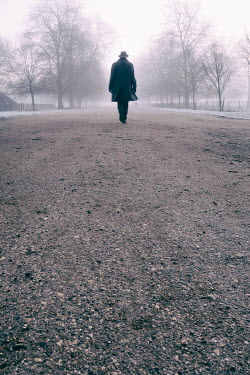 Tim Robinson MAN IN HAT WALKING ON ROAD IN WINTER Men