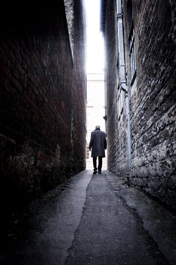 Tim Robinson BALD MAN WALKING IN NARROW PASSAGEWAY Men