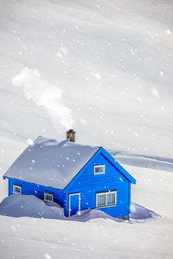 Des Panteva BLUE HOUSE IN SNOW WITH SMOKING CHIMNEY Houses