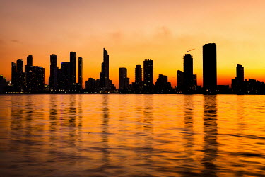 Evelina Kremsdorf CITY SKYLINE WITH OCEAN AT SUNSET Specific Cities/Towns