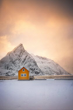 Evelina Kremsdorf YELLOW HOUSE BY OCEAN WITH SNOWY MOUNTAIN Houses