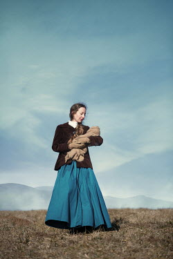 Magdalena Russocka historical woman holding baby in countryside