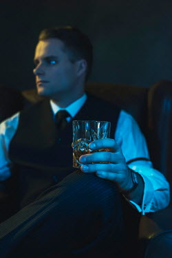Ysbrand Cosijn Gangster sitting with glass of whiskey