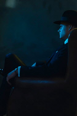 Ysbrand Cosijn Gangster with fedora sitting in chair