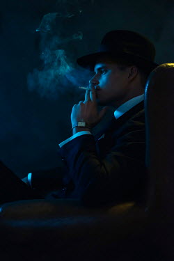 Ysbrand Cosijn Gangster with fedora smoking in chair