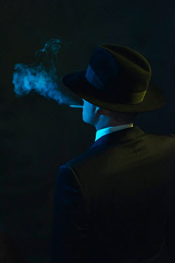 Ysbrand Cosijn Gangster with fedora smoking in shadow