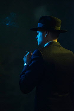 Ysbrand Cosijn Gangster with fedora holding cigarette in shadow