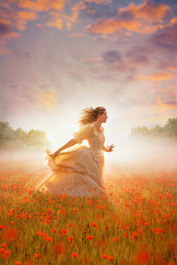Lee Avison victorian woman running through a poppy meadow at dawn