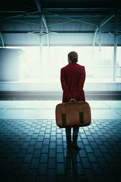 Magdalena Russocka woman with suitcase on railway platform