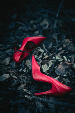 Magdalena Russocka red stiletto shoes lying in leaves