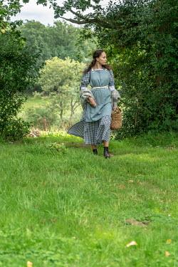 Stephen Mulcahey A maid walking along a forest path