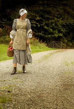 Stephen Mulcahey A maid walking along a dusty path
