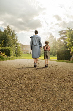 Stephen Mulcahey amother and son walking towards a boarding school