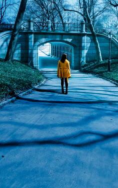 Stephen Mulcahey A woman alone walking through central park alone