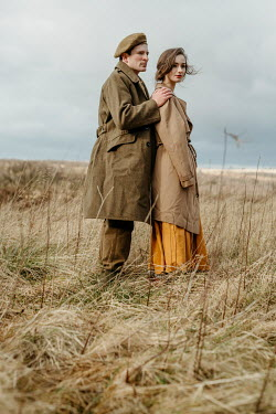 Shelley Richmond Man in military uniform standing with woman in field